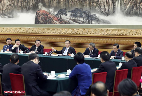Chinese Premier Li Keqiang, who is also a member of the Standing Committee of the Political Bureau of the Communist Party of China (CPC) Central Committee, joins a panel discussion with the deputies from Hunan Province at the first session of the 13th National People's Congress in Beijing, capital of China, March 12, 2018. (Xinhua/Ding Lin)